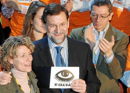 Imagen de una convención nacional del PP, donde se puede ver a Isabel Llinàs, Mariano Rajoy y Alberto Ruiz Gallardón.