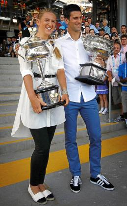 Current Australian Open tennis champions Serbia's Novak Djokovic (R) and Victoria Azarenka from Belarus pose with the championship trophies to the official draw ceremony at Melbourne Park January 10, 2014. The Australian Open tennis tournament begins on January 13.