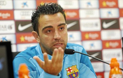 Imagen del centrocampista del Barcelona Xavi Hernández durante la rueda de prensa ofrecida ayer.