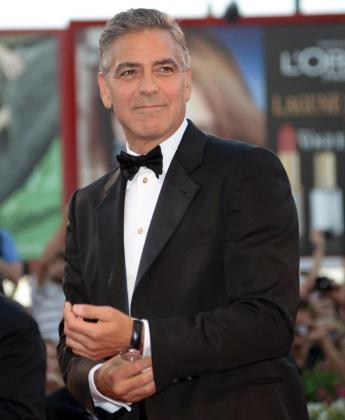 El actor estadounidense George Clooney sonríe a su llegada a la presentación de la película 'Gravity'.