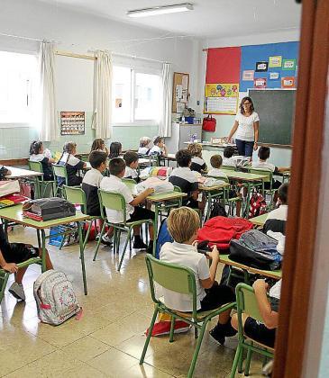 Imagen de archivo de escolares en clase.