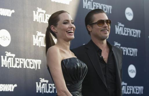 Angelina Jolie y actor Brad Pitt , durante la presentación de Maléfica.