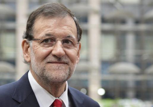 El presidente del Gobierno español, Mariano Rajoy, sonríe a su llegada a la segunda jornada de la cumbre de la Unión Europea en Bruselas (Bélgica) este viernes 27 de junio de 2014.