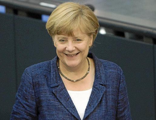 Angela Merkel, sonriente, ayer en Bundestag, a pesar del escándalo del espionaje norteamericano en su país.
