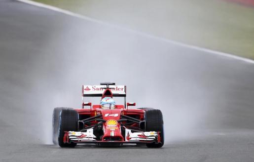 El español Fernando Alonso, durante la sesión de clasificación del Gran Premio de Gran Bretaña.