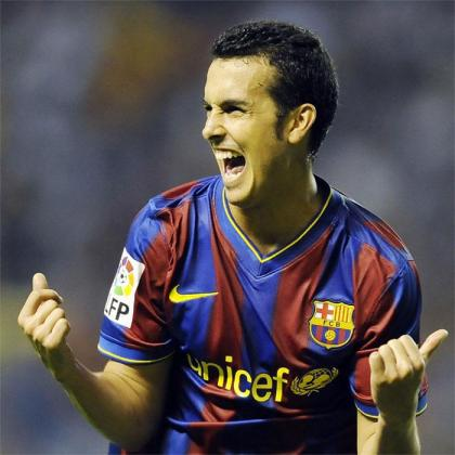 El jugador del FC Barcelona Pedro Rodríguez celebra un gol con la camiseta culé.