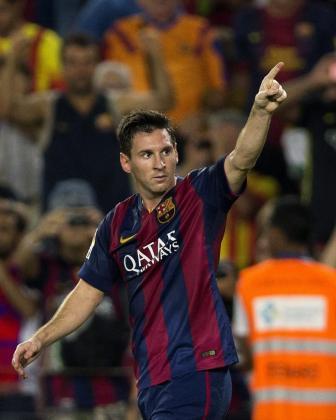 El delantero argentino del FC Barcelona Lionel Messi celebra su primer gol.