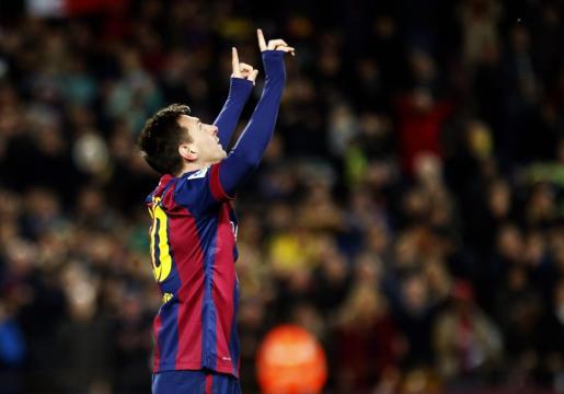 El jugador del FC Barcelona Lionel Messi celebra el primer gol conseguido en el partido ante el Espanyol este domingo.