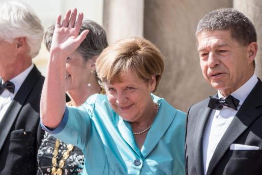 La canciller alemana Angela Merkel, junto a su marido Joachim Sauer.