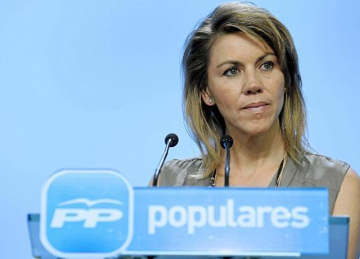 María Dolores de Cospedal, durante la rueda de prensa que ofreció ayer en la sede del PP.