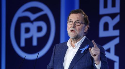 El líder del PP y presidente del Gobierno en funciones, Mariano Rajoy, durante su intervención en la Convención del PP sobre el Pacto por los Servicios Sociales.