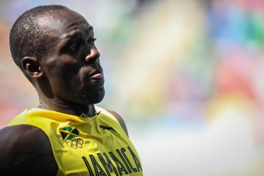 El atleta Usain Bolt de Jamaica durante la competición clasificatoria de los 100 m masculino.