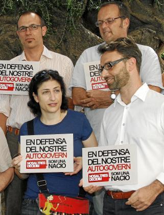 Barceló, Lladó y Huguet, con Bujosa, en un acto plural.