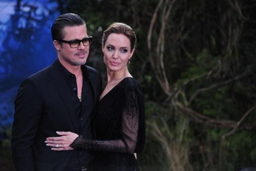 Los actores Angelina Jolie y Brad Pitt durante la premier de 'Maléfica'.