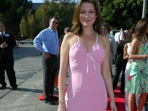 La actriz Lisa Lynn Masters con algunos de sus compañeros de reparto en la serie 'Unbreakable Kimmy Schmidt'.