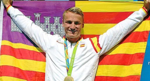 El campeón olímpico Marcus Cooper.