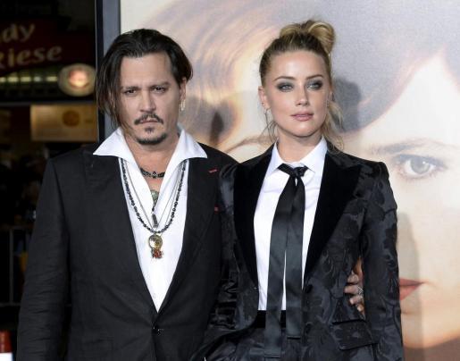 Fotografái de archivo de los actores Johnny Depp y Amber Heard.