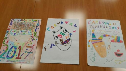 En la imagen, los tres carteles finalistas.