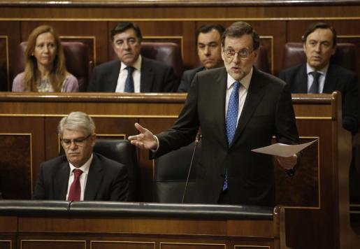 El presidente del Gobierno, Mariano Rajoy, durante la sesión de control al Gobierno que se celebra en el pleno del Congreso de los Diputados.