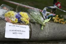 Flowers and messages are left near the scene of an attack by a man driving a car and weilding a knife left five people dead and