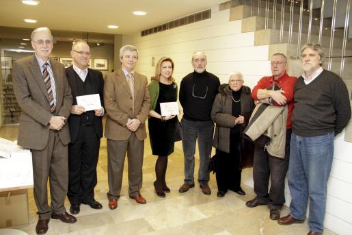 Pere Comas, Sebastià Serra, Llorenç Julià (subdirector de Sa Nostra), Maria Antònia Munar, Ferran Aguiló, Catalina Sureda, Enrique Lázaro y Climent Picornell.