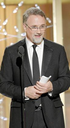 """David Fincher accepts the award for best director of a motion picture for """"The Social Network"""" at the 68th annual Golden Globes Awards in Beverly Hills, California January 16, 2011. REUTERS/Paul Drinkwater/NBC/Handout (UNITED STATES) NO SALES. NO ARCHIVES. FOR EDITORIAL USE ONLY. NOT FOR SALE FOR MARKETING OR ADVERTISING CAMPAIGNS. NO THIRD PARTY SALES. NOT FOR USE BY REUTERS THIRD PARTY DISTRIBUTORS.THIS IMAGE HAS BEEN SUPPLIED BY A THIRD PARTY. IT IS DISTRIBUTED, EXACTLY AS RECEIVED BY REUTERS, AS A SERV"""