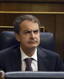 Spain's PM Jose Luis Rodriguez Zapatero reacts in his seat during a cabinet control session in parliament in Madrid