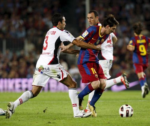 Imagen del enfrentamiento del Mallorca y el Barça en el Camp Nou en la Liga 2009-2010.