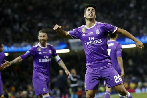 El centrocampista del Real Madrid Marco Asensio celebra su gol ante el Juventus.