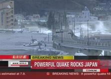 Frame grab of a tsunami carrying boats across waters in Kamaishi city port