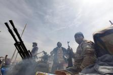 Rebels celebrate after recapturing the town of Ras Lanuf, from forces loyal to Libyan leader Muammar Gaddafi