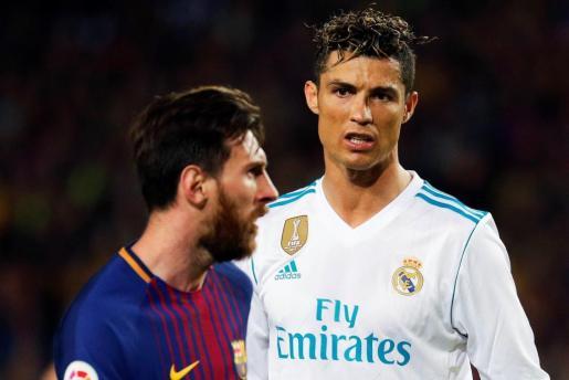 Leo Messi y Cristiano Ronaldo, durante el encuentro del Nou Camp.