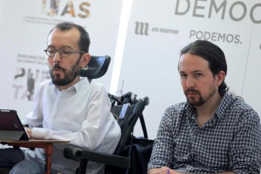 El líder de Podemos, Pablo Iglesias y el secretario de Organización, Pablo Echenique.
