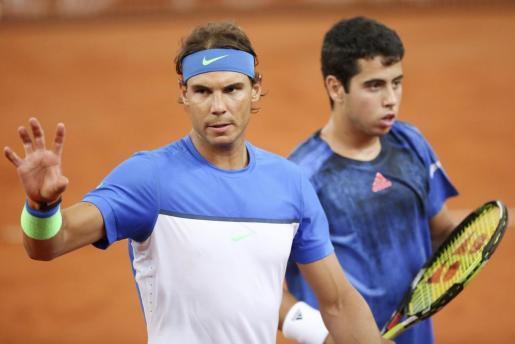 Rafael Nadal y Jaume Munar, durante el partido de dobles contar los italianos Bolelli y Fognini en el torneo de Hamburgo en 2015.