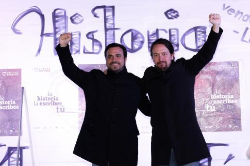 El secretario general de Podemos, Pablo Iglesias, y el coordinador federal de Izquierda Unida, Alberto Garzón.