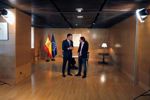 El presidente del gobierno Pedro Sánchez y el líder de Podemos Pablo Iglesias.