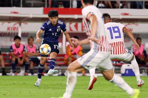Imagen del jugador del Real Mallorca Take Kubo en un momento del partido disputado entre la selección de Japón y la de Paraguay.