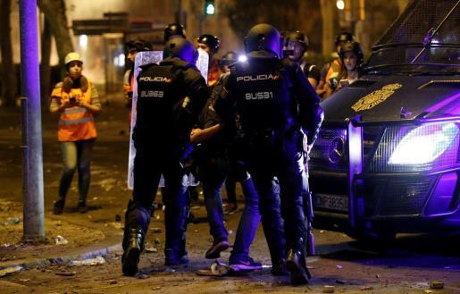 Detención del fotoperiodista de 'El País' Albert Garcia
