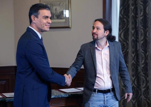 Pedro Sánchez y Pablo Iglesias han llegado a un preacuerdo de gobierno PSOE-Unidas Podemos.