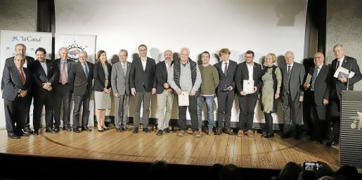 Los galardonados, junto a Eduardo Gamero, el alcalde de Palma y los directores generales de Turisme Andreu Serra y Rosana Morillo.
