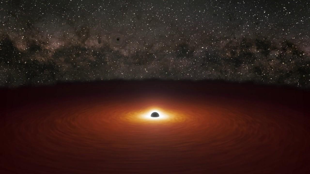 El telescopio Spitzer capta el clímax de una 'danza' de agujeros negros