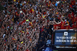 Spain's national soccer team players celebrate their Euro 2012 victory on an open top bus during a parade in downtown Madrid