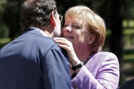 Merkel, satisfecha con las reformas de Rajoy, que asegura que no tocará las pensiones