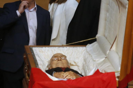 Spain's Labour Minister Banez and Spain's labour union CCOO General Secretary Toxo walk behind the coffin of the veteran Communi