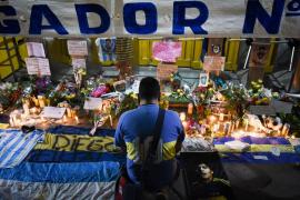 "People gather to mourn the death of soccer legend Diego Maradona, outside the Alberto J. Armando ""La Bombonera"" stadium, in Buenos Aires"