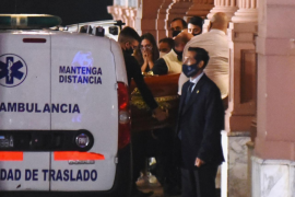 The coffin holding the body of soccer legend Diego Maradona arrives at the Casa Rosada presidential palace, in Buenos Aires