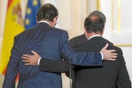 Hollande y Rajoy presionan a Merkel al exigir avanzar hacia la unión bancaria