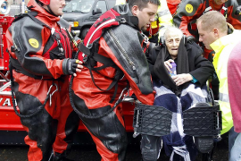 Rescue workers carry a wheelchair-bound resident from flood waters brought on by Hurricane Sandy in Little Ferry