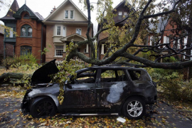 A car is seen burned out in an electrical fire after a tree fell over a power line due to the remnants of Hurricane Sandy in Tor