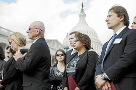 Family members and victims of mass shootings stand during a news conference by the Brady Campaign to Prevent Gun Violence callin